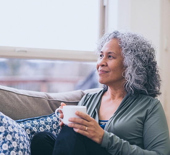 woman sitting enjoying a cup of coffee
