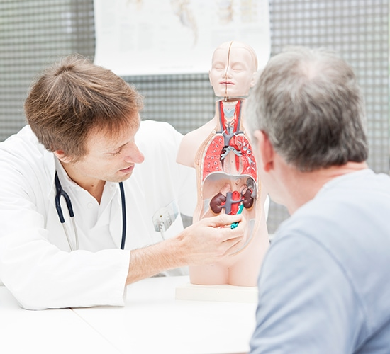 doctor explaining urologic conditions to a patient