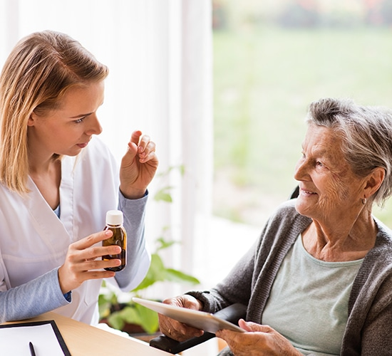 caregiver providing a medication review with senior patient