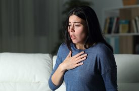 woman gasping for breath